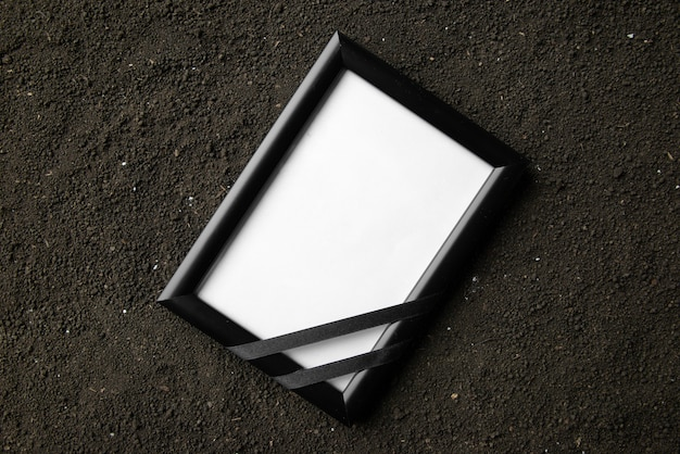 Top view of picture frame on the dark soil