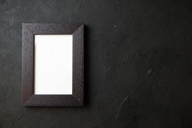 Top view of picture frame on a dark wall