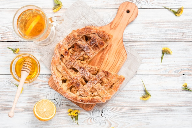 Top view of pie with tea and honey