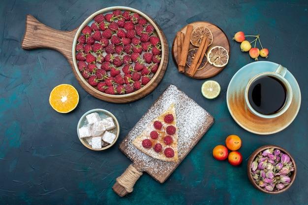 Top view piece of cake baked sweet with raspberries and tea on dark floor berry sugar cake pie bake biscuit