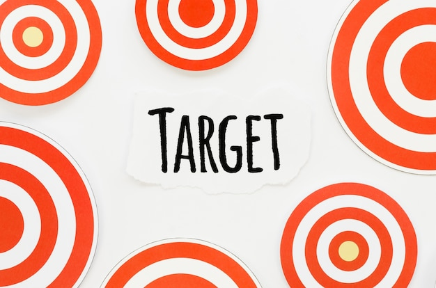 Top view of piece of paper with target and circular marks