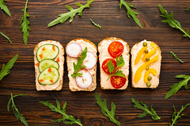 Top view pieces of bread with veggies