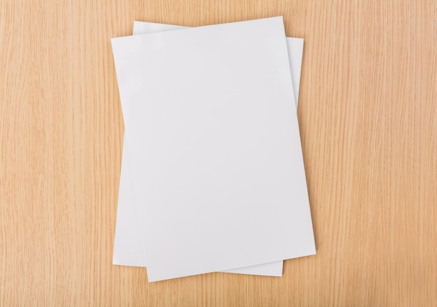 Top view of pieces of paper on wooden table