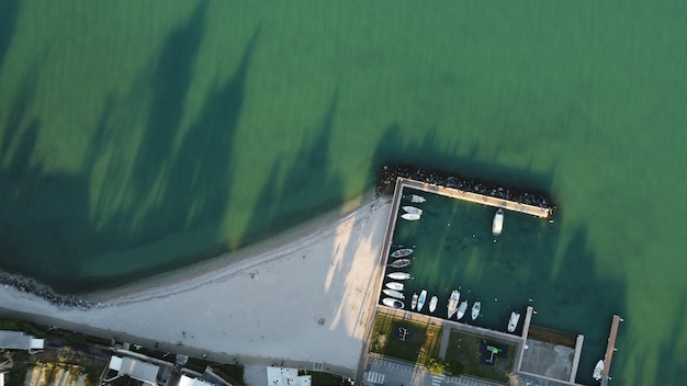 Top view of a pier by the sea captured during the daytime
