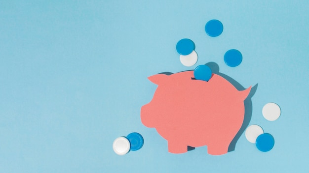 Top view piggy bank on blue background