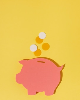 Top view piggy bank on yellow background