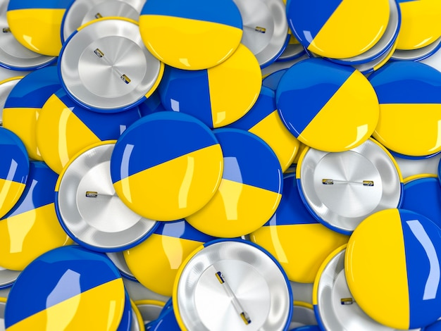 Top view of pile of button badges with flag of ukraine. realistic 3d render