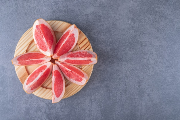 Top view. pile of fresh organic grapefruit slices.