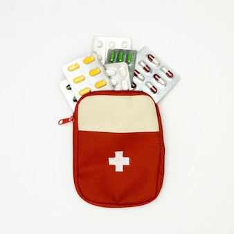 Top view of pill foils with first aid kit