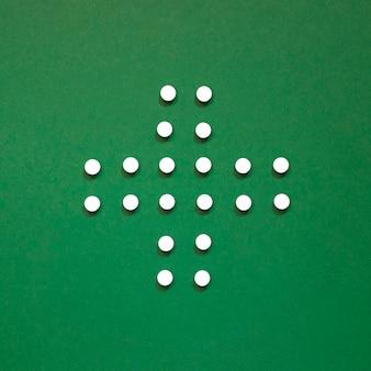 Top view of pills in cross shape
