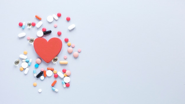 Top view pills and heart with copy space