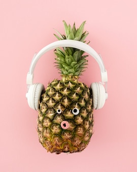 Top view pineapple with headphones