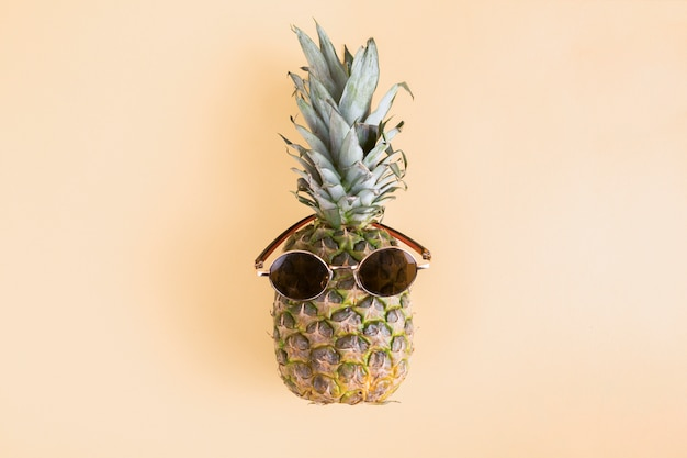 Top view pineapple with sunglasses