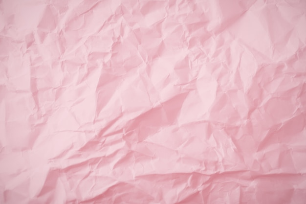 Top view of  pink crumpled paper background.