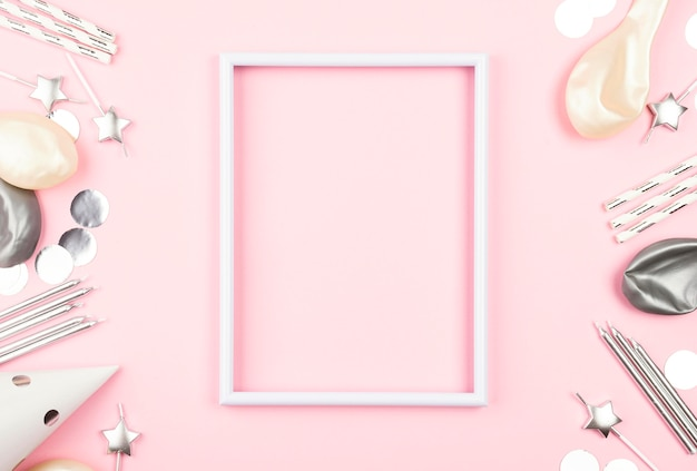 Top view pink frame with birthday decorations