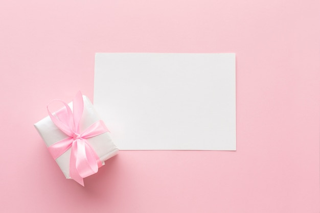 Top view of pink gift with paper
