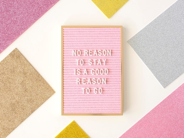 Top view pink motivational text board