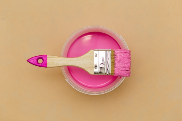 Top view of pink paint and brush