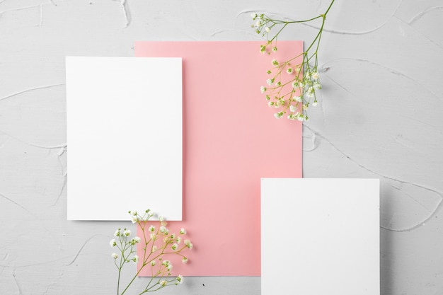 Top view of a pink paper letter and flowers with copy space