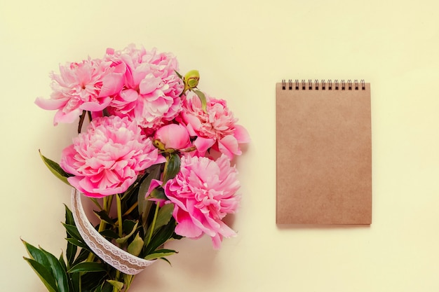 Top view of pink peony flowers with copy space. floral background.