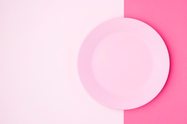 Top view pink plate on table