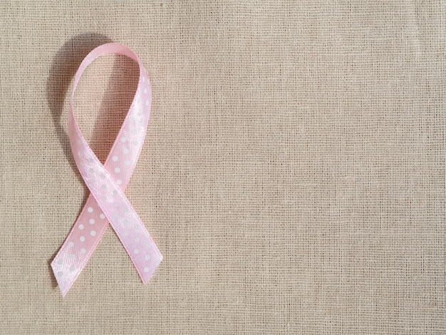 Top view pink ribbon on bag texture
