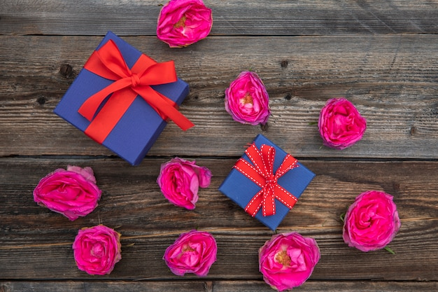 Top view pink roses and gifts