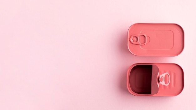 Top view pink rounded rectangle tin cans with copy-space