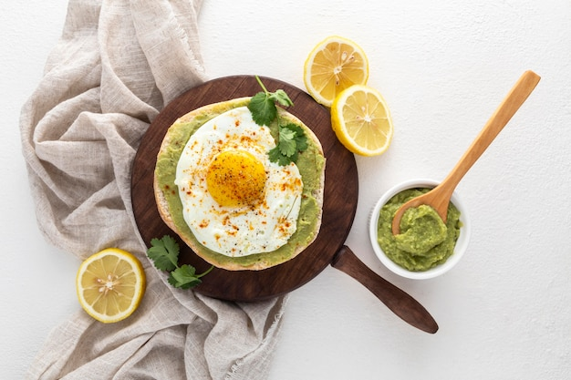 Top view pita with avocado spread and fried egg