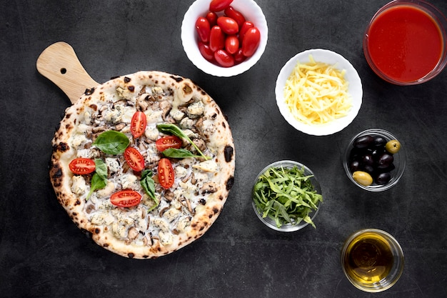 Top view pizza and toppings arrangement
