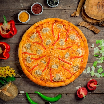 Top view of pizza with mushrooms and bell peppers