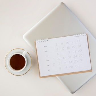 Top view planner calendar and cup of coffee