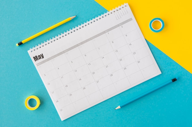 Top view planner calendar on yellow and blue background