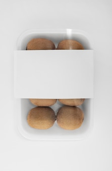 Top view of plastic packaging with kiwis