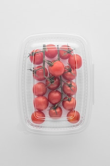 Top view of plastic packaging with tomatoes
