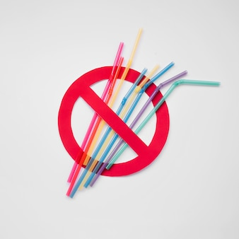 Top view plastic straws pollution sign