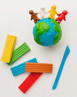 Top view of plasticine earth and people