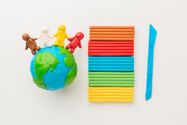 Top view of plasticine people and globe