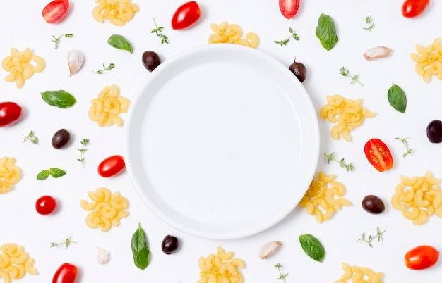 Top view plate surrounded by vegetables