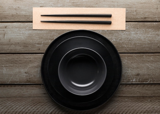 Top view of plate with chopsticks and bowl