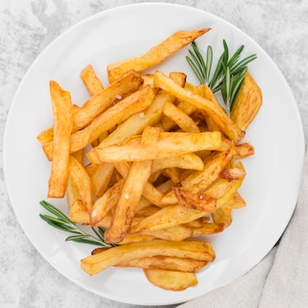 Top view plate with delicious french fries