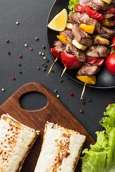 Top view of plate with delicious kebab and salad