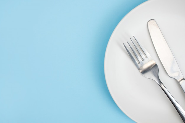 Top view plate with a fork