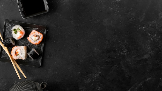 Top view plate with fresh sushi rolls with copy-space