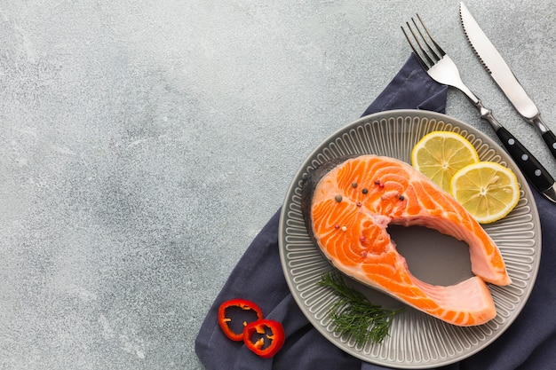 Top view plate with salmon and lemon
