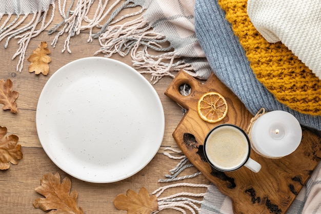 Top view of plate with sweater and coffee cup