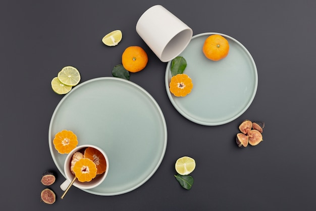 Top view of plate with tangerine slices and figs