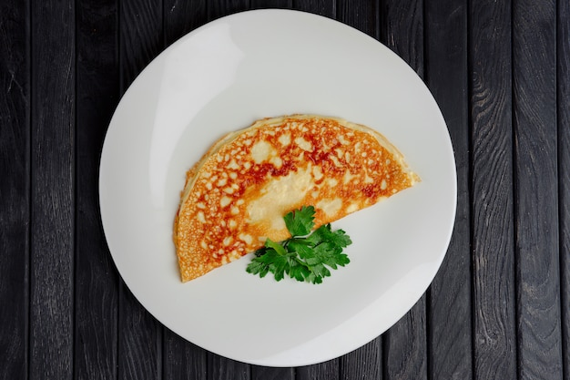 Top view of plate with thin omelet