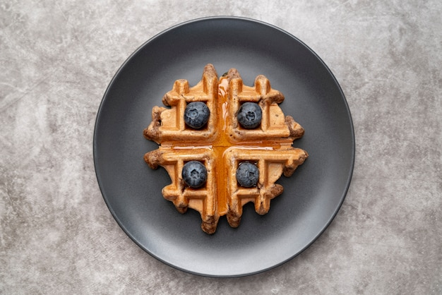 Top view of plate with waffle and blueberries