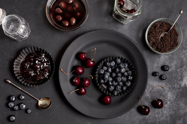 Top view plates with blueberries and cherries